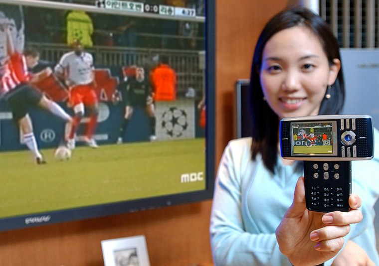 A promoter shows Samsung Electronics' third satellite Digital Multimedia Broadcasting (DMB) phones, SCH-B200, in Seoul