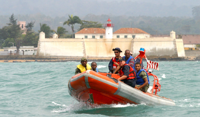 U.S. Coast Guardsmen teach Sao Tome army soldiers how tomaneuever a boat off thecoast of the oil-rich Island of Sao Tome and Principe, in this July 20 photo.