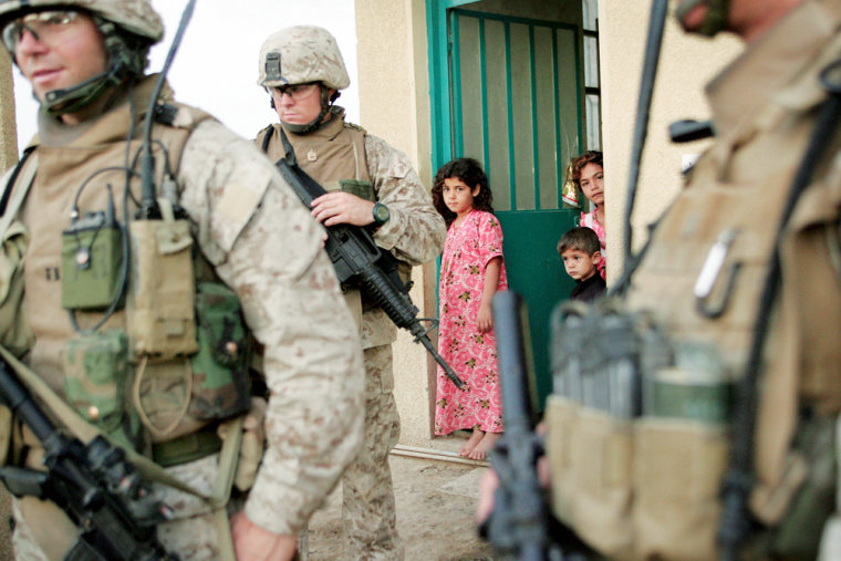 Iraqi Soldiers Search Homes Looking For Weapons In Predawn Raid