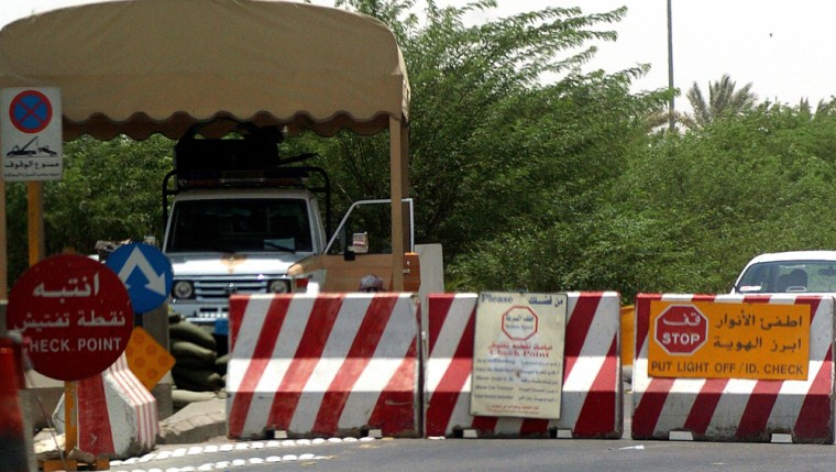 Security vehicle is stationed at entrance of diplomatic quarters in Riyadh