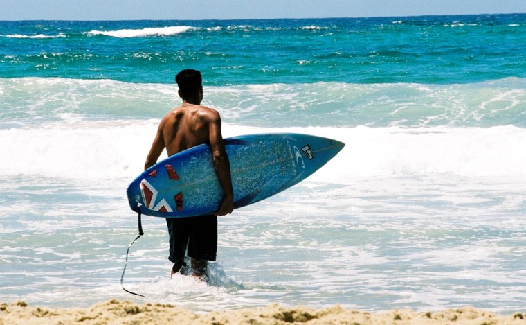 A surfer at Neve Dekalim beach in Gush Katif, an Israeli settlement that will be effected by the Gaza disengagement plan when it goes into effect on August 15.