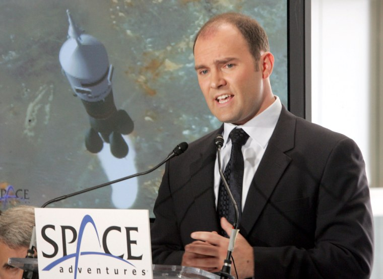 """Eric Anderson, president and CEO of Space Adventures Ltd., speaks during a news conference in New York onAug. 10. Space Adventures, the company that has sent """"space tourists"""" up to the International Space Station, is planning a new mission: rocketing rich people around the dark side of the moon."""