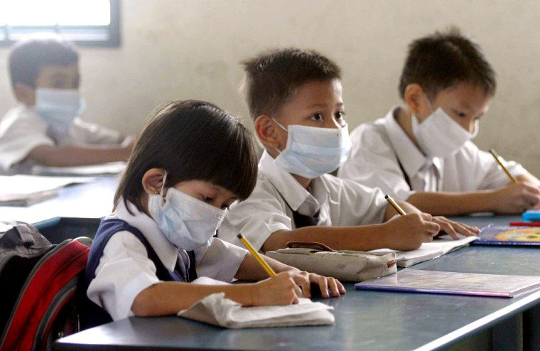 Malaysian students wear masks while attending lesson at a school in Kuala Lumpur