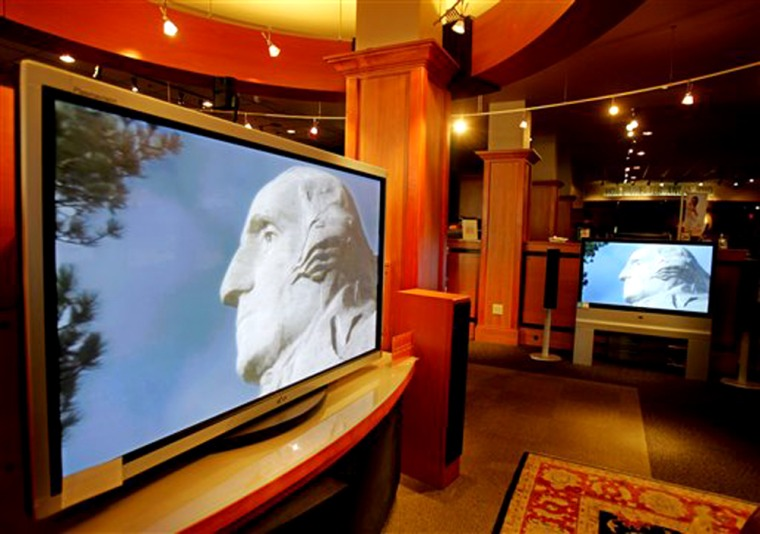 Flat-panel TVs on display at Magnolia Audio and Video store in Palo Alto, Calif., earlier this month.