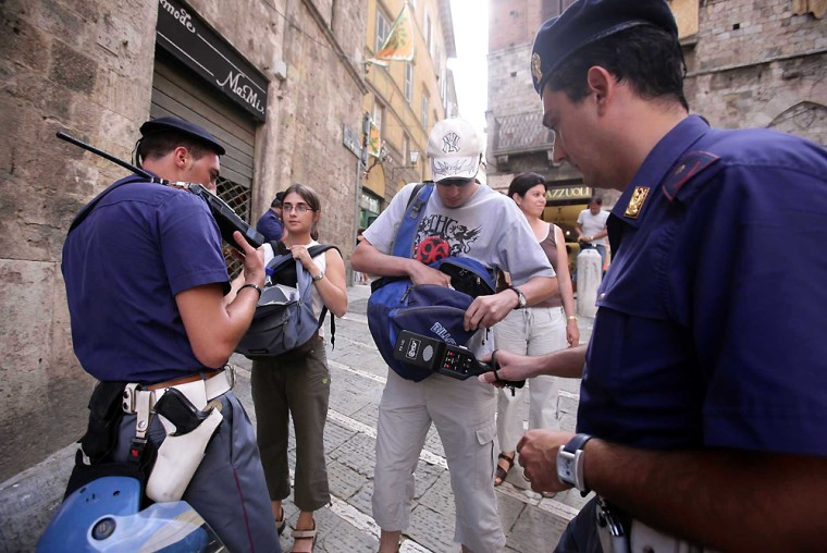 Italian police officers check touristson Monday near Piazza del Campo square in Siena, Italy. The Italian Interior Ministry said exercises will be held next month to test the nation's readiness for any terrorist strike.