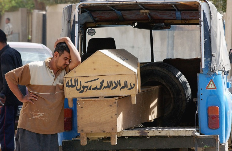 Scores Killed, Wounded In Baghdad Triple Bombing