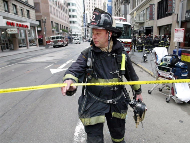 San Francisco firefighter crosses a police line in downtown San Francisco