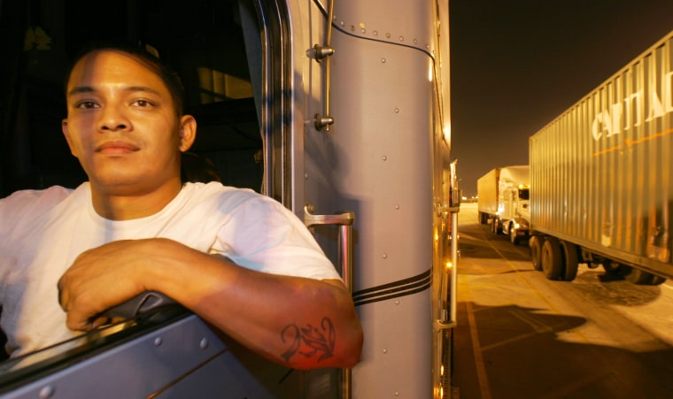 Wilfredo Jimenez waits in his truck in line at the entrance to the cargo terminal at the Port of Los Angeles earlier this month.