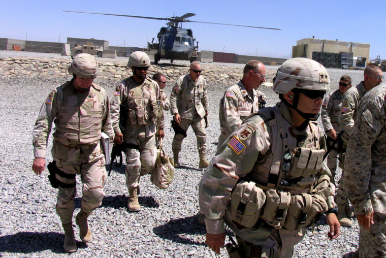 U.S. Army Maj. Gen. Jason Kamiya, foreground right, arrives at a military base in Paktika province ineastern Afghanistan on Tuesday.