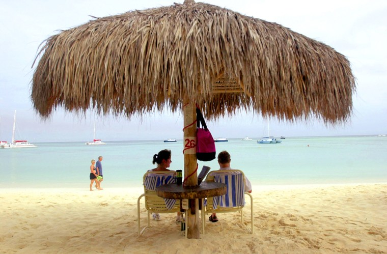 Tourists relax on Palm Beach in Aruba near the Holiday Inn hotel where Natalee Holloway stayed before she disappeared during a graduation trip to Aruba.