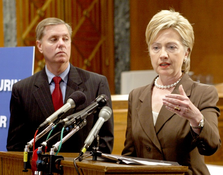 US Senators Hillary Clinton and Lindsey Graham hold a news conference on Capitol Hill