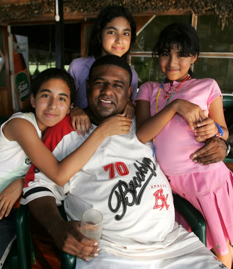 Plane crash survivor Jose Leandro Vivas poses with his daughters Joshelyn, 15, left, Jacquelyne, 12, above, and Jharline, 10, right, andduring an interview in Pucallpa, Peru, on Wednesday.