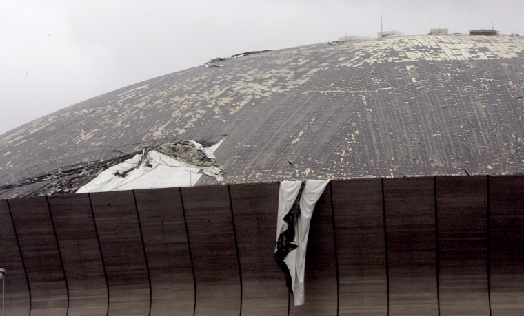 The roof of the Louisiana Superdome is shredded by Hurricane Katrina's strong winds on Monday.
