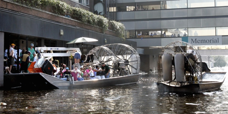 An airboat pulls up to Memorial Hospital in New Orleans on Wednesday in order to evacuate patients. Two nearby hospitals have yet to be evacuated and issued pleas for help Thursday.