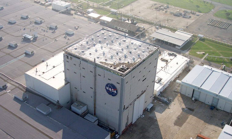 An aerial photograph shows damage to the roof of the Vehicle Assembly Building at NASA's Michoud Assembly Facility in New Orleans. The shuttle fuel tanks at the facility are undamaged, NASA says, but it will be weeks before workers can return.