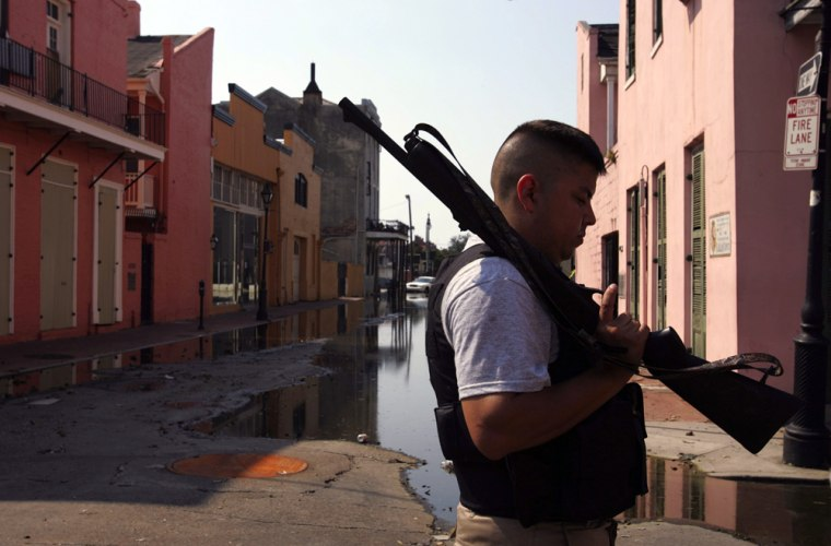 Rusk County Sheriff's deputy looks over a vacant French Quarter street in New Orleans in the aftermath of Hurricane Katrina