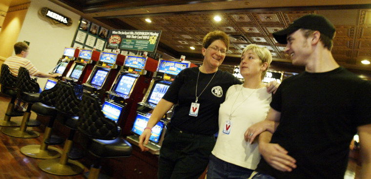 New Orleans emergency medical technician Keeley Williams, left, accompanied by Victoria Carter and Topher Cummings, right, at a casino in Las Vegas, on Wednesday.
