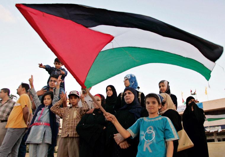 Palestinian girl waves Palestinian flag during celebration ceremony inside former southern Gaza Strip settlement of Neve Dekalim
