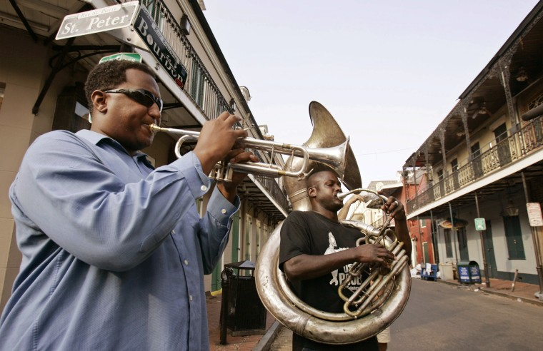 Emile Turner and Michael Foster play live music on Bourbon Street in New Orleans