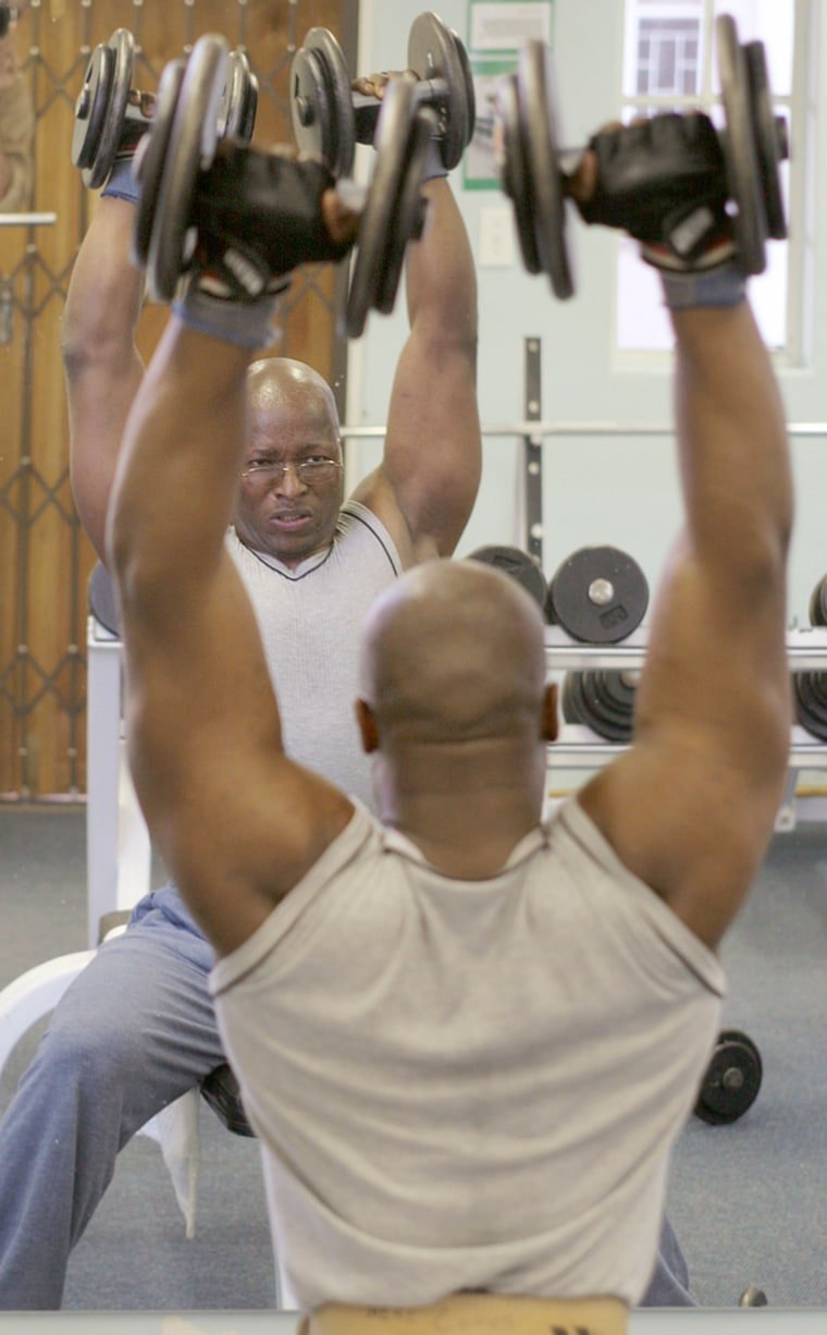Pvt. Andries Nhlengethwa lifts weights during a workout at the gym in Pretoria, South Africa. Nhlengethwa is one of the few South African soldiers living openly with the AIDS virus.