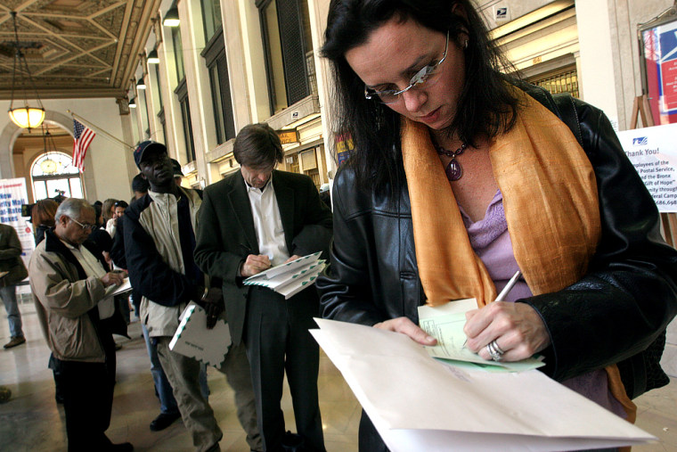 New Yorkers prepare to mail their income tax returns at Manhattan's General Post Office on the deadline for filing, April 15, 2005.