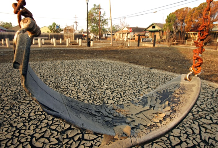 Dried mud from the floodwaters of Hurricane Katrina encrusts a children's swing in a playground in New Orleans on Sept. 18.