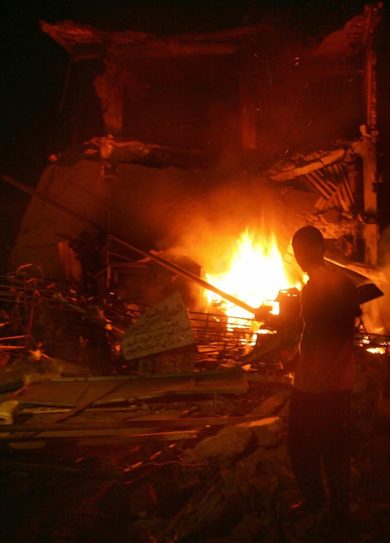A Palestinian man looks at the destructi