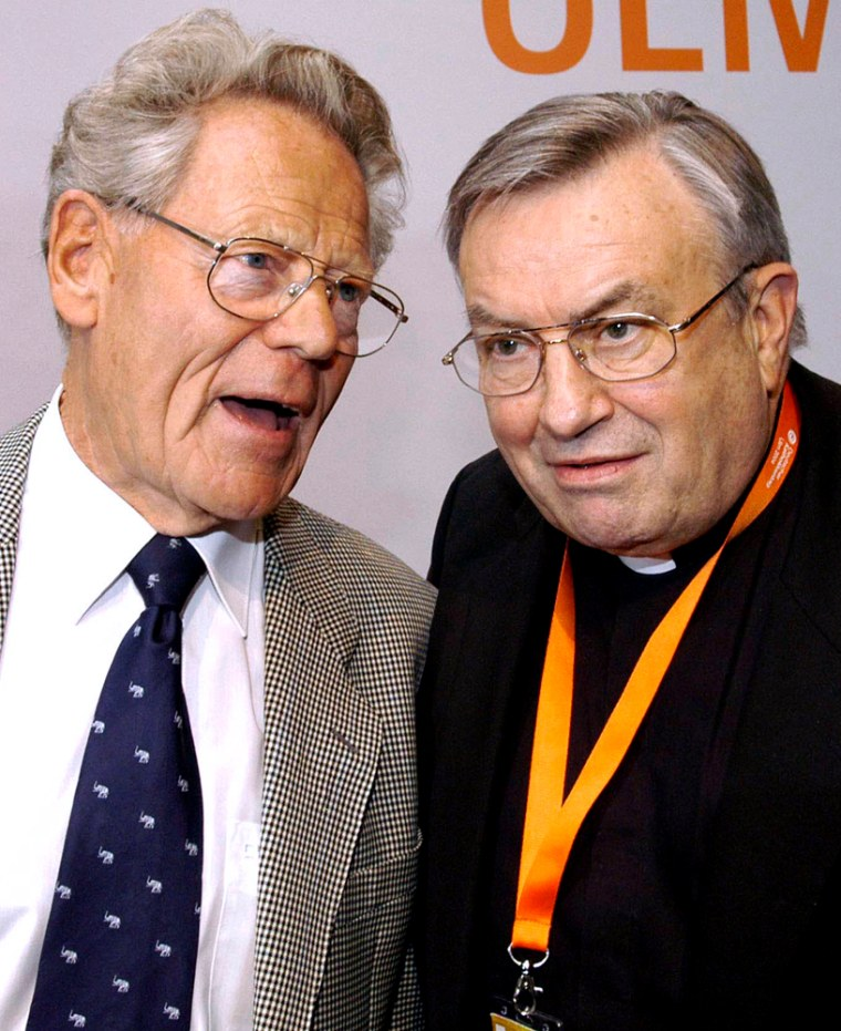 German Cardinal Karl Lehmann, right,talks with dissident Swiss theologian Father Hans Kueng, who was stripped of his teaching rights at Catholic universities by the Vatican in 1979, in this June 2004 photo.