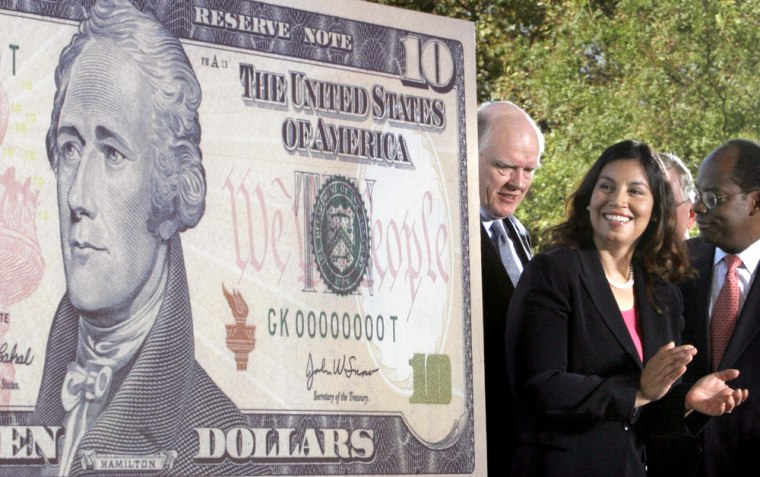 Treasury Secretary John Snow, left, U.S. Treasurer Anna Escobedo Cabral and Federal Reserve Vice Chairman Roger Ferguson, Jr. unveil the new $10 bill on Ellis Island in New York harbor Wednesday.