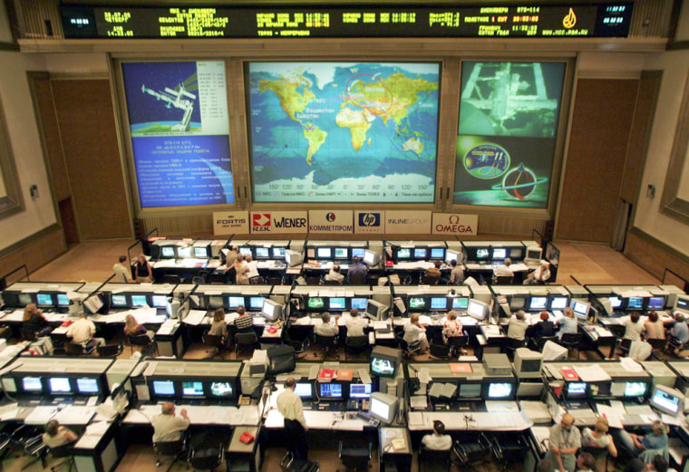 Experts of Russian Mission Control Centre watch docking of Discovery space shuttle