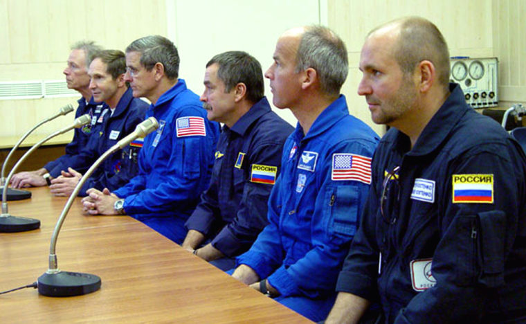 Space Adventures exec Sergei Kostenko, furthest right,attends a pre-launch briefing at the Baikonur Cosmodrome in Kazakhstan. From left, the others are U.S. millionaire Greg Olsen, Russian cosmonautValery Tokarev, U.S. astronaut Bill McArthur and Kostenko's fellow backup crew members, Mikhail Tyurin and Jeffrey Williams.