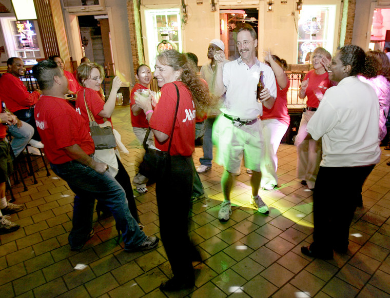 Workers from the Marriott hotel have some fun at Razzoo on Bourbon Street, Friday night.