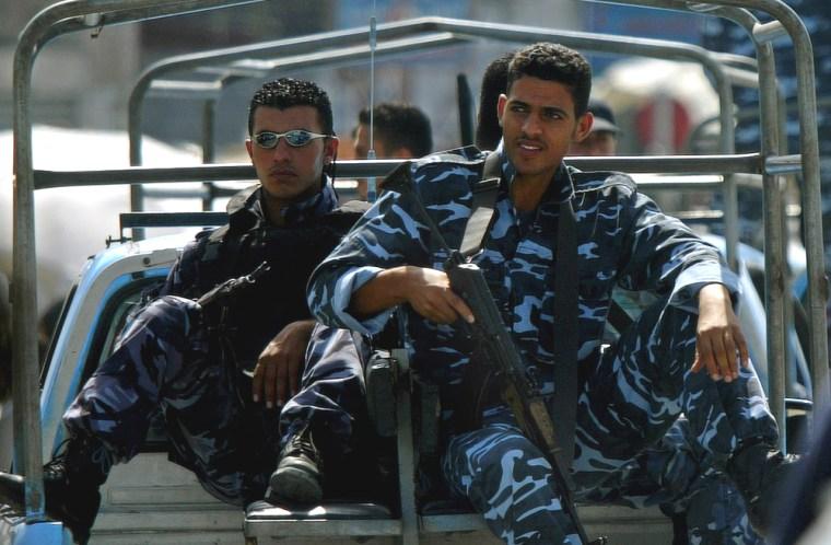 Palestinian police officers patrolthe streets of the Jebaliya refugee Camp, northern Gaza Strip, onSunday.