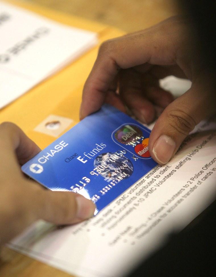 Official holds FEMA debit card inside Reliant Arena