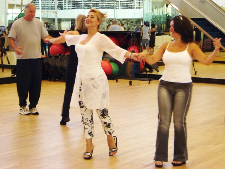 Mojan Moinzadeh and Mimi Yazdi practice the cha-cha at a dance workshop held at The SportsClub/LA in September.