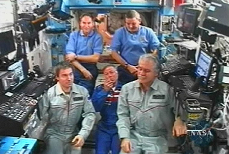 US scientist and businessman Gregory Olsen talks during news conference from Unity module of ISS