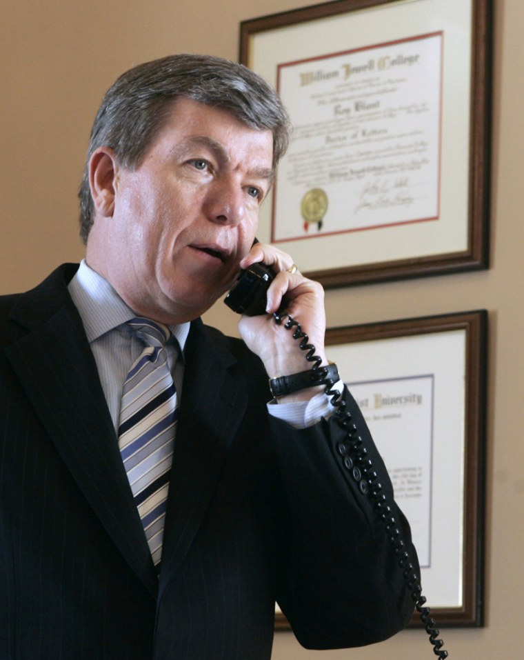 Temporary House Majority Leader Roy Blunt works telephone first day on new job