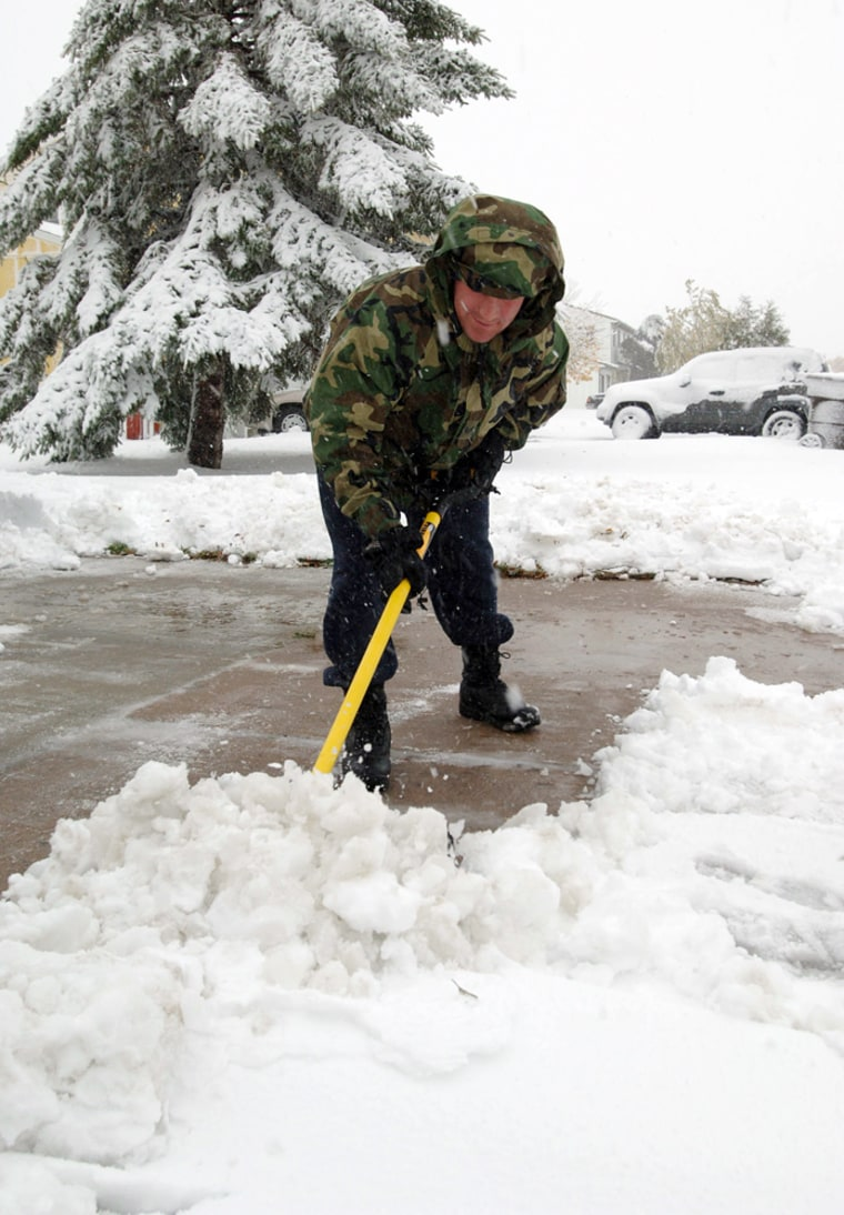Senior Airman Kevin O'Reilly clears his base housing driveway at Minot Air Force Base in North Dakota on Wednesday.