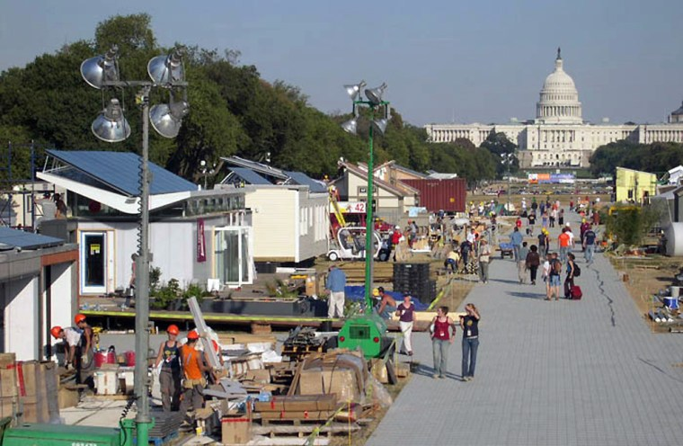 Congress is seen in the distance as a solar village is built on the National Mall this week by university teams competing in the 2005 Solar Decathlon.