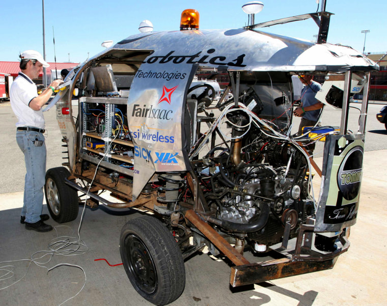 """Perrone works on robotic vehicle \""""Tommy\"""", set to take part in DARPA 2005 challenge race, in Fontana"""