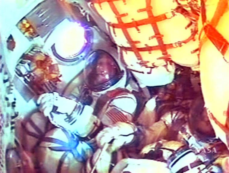 American Greg Olsen is seen  along with Soyuz TMA spacecraft Commander Valery Tokarev after launch on Soyuz TMA spacecraft