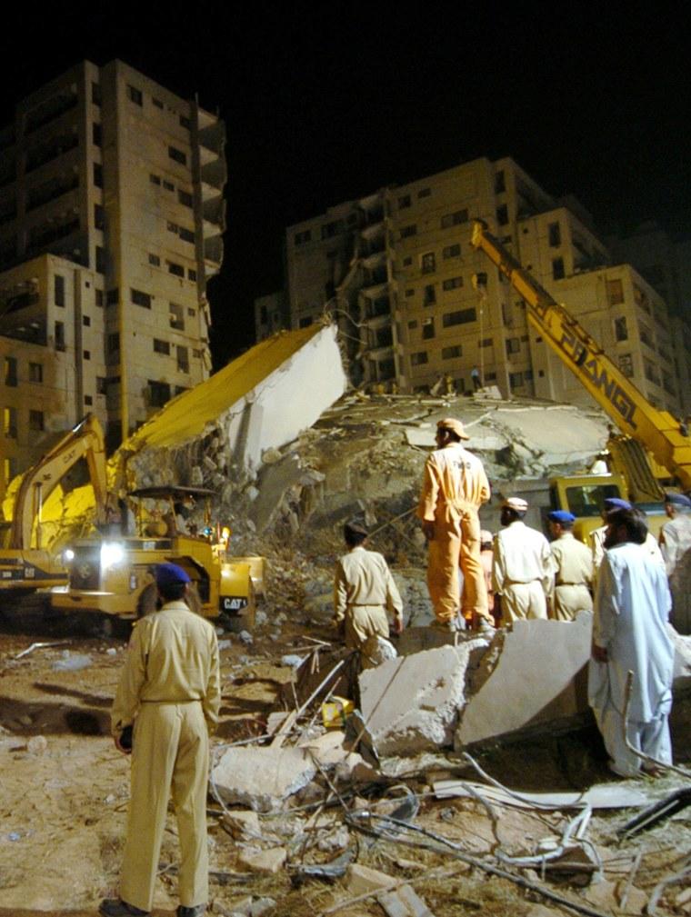 Pakistani rescuers remove debris from th