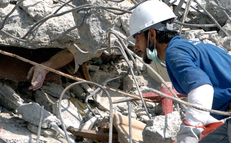 A Pakistani rescuer approaches the hand