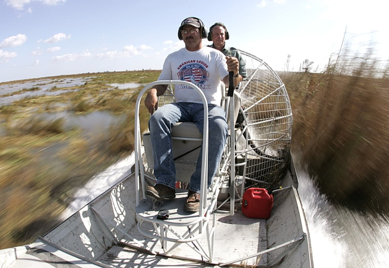 Pilot Richard pilots his airboat past the tall rush grass of the Rockefeller Wildlife Refuge outside Cameron