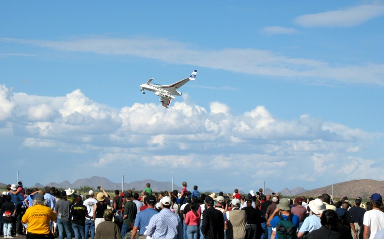 XCOR's EZ-Rocket plane soars over the crowd in Las Cruces, N.M., on Sunday.