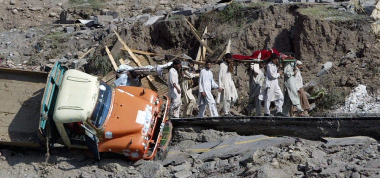 Residents move their injured relatives to safer place in Balakot