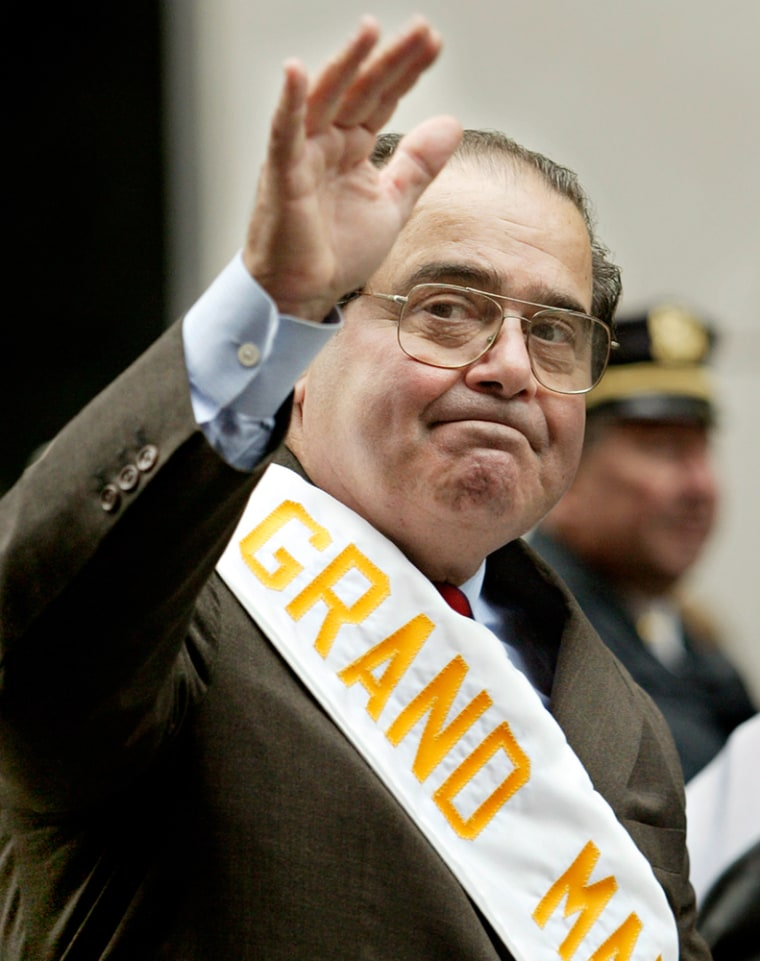 Supreme Court Justice Antonin Scalia waves to the crowd Monday in his role as grand marshal for the 61st Annual Columbus Day Parade in New York City.