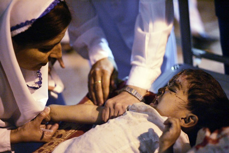 A doctor treats an earthquake victim in the northern Pakistani town of Abbottabad, on Monday.