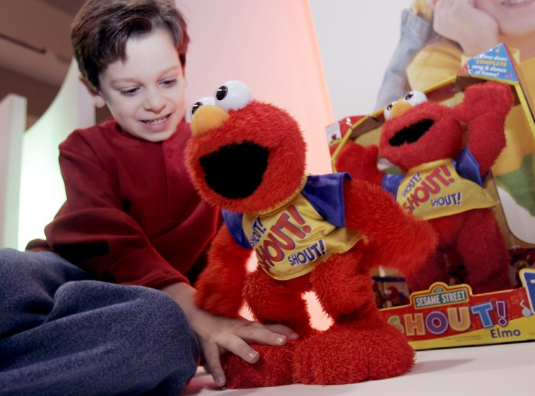 Matthew Conboy, 6, of Elmwood Park, N.J., plays with a Shout Elmo by Mattel during Toy Wishes Magazine Holiday Preview in New York.