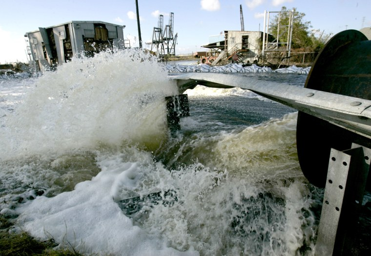 Floodwater being drained from New Orleans' lower ninth ward is pumped Oct. 3through a 42-inch diameter pipe at a rate of 56,000 gallons-per-minute.